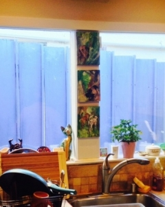 Dee & Ed's kitchen window with the Black Mouth Cur & Visla triptych!