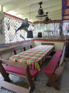 One of the communal tables with its madras table cloth